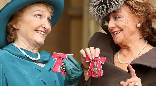 Coronation Street actresses Eileen Derbyshire (left) and Barbara Knox, with their MBE medals