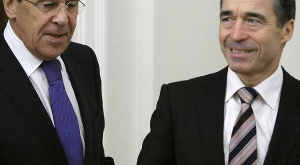 Russian Foreign Minister Sergey Lavrov, left, with NATO chief Anders Fogh Rasmussen in Moscow