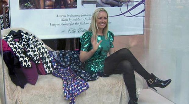 Stella English sits in a window in a tiny dress for the latest Apprentice task