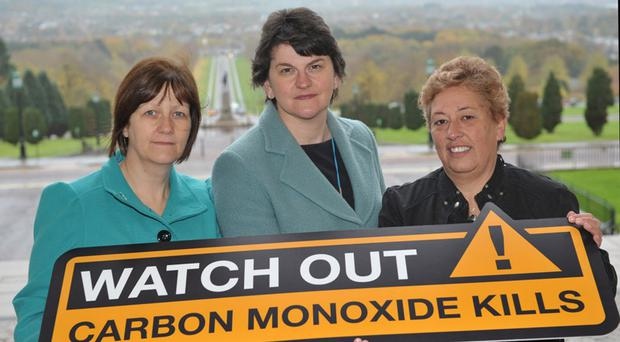 Health and Safety Minister Arlene Foster today launched a new public awareness campaign to raise awareness of the dangers of carbon monoxide poisoning. Delivered by the Health and Safety Executive for Northern Ireland (HSENI), the hard hitting campaign âWatch Out. Carbon Monoxide Killsâ, is being supported by the families of Neil McFerran and Aaron Davidson, who tragically died from carbon monoxide poisoning in Castlerock, in August. Pictured with the Health and Safety Minister Arlene Foster are Catherine McFerran (L) and Katrina Davidson.
