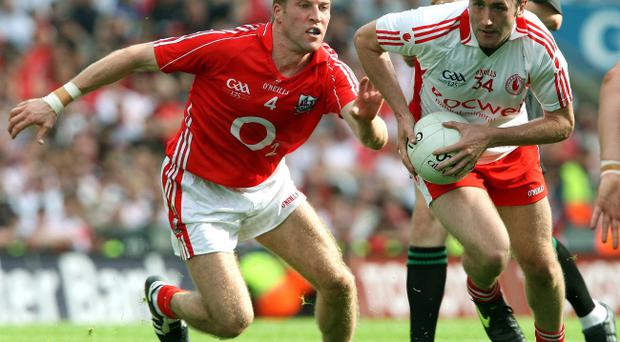 Tyrone's Stephen O'Neill (right) is among a number of high-profile target men who can convert quickly-delivered possession into points