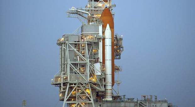 Space shuttle Discovery on the launch pad at Kennedy Space Centre in Cape Canaveral, Florida (AP)