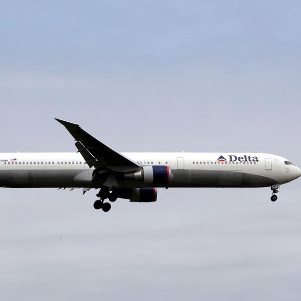 A Delta Air Lines passenger jet was given the all-clear after making an emergency landing in India