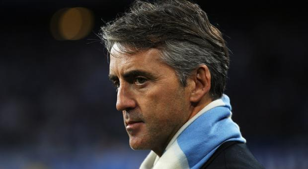 POZNAN, POLAND - NOVEMBER 04: Manchester CIty Manger Roberto Mancini looks on prior to the UEFA Europa League Group A match between KKS Lech Poznan and Manchester City at the Bulgarska Street Stadium on November 4, 2010 in Poznan, Poland. (Photo by Bryn Lennon/Getty Images)