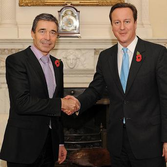 Fogh Rasmussen said he was 'confident' that the UK will fully live up to its military commitments (AP)