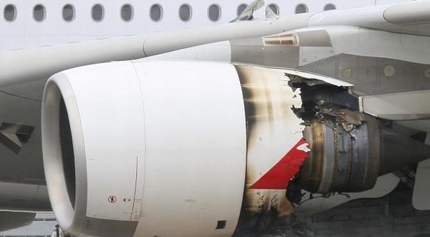 Qantas has suspended A380 flights after an engine problem forced an emergency landing in Singapore (AP)
