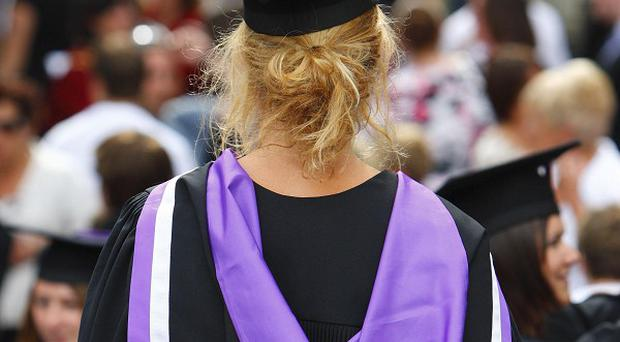 Ernst and Young said half of the new employees would be graduates taken on next year