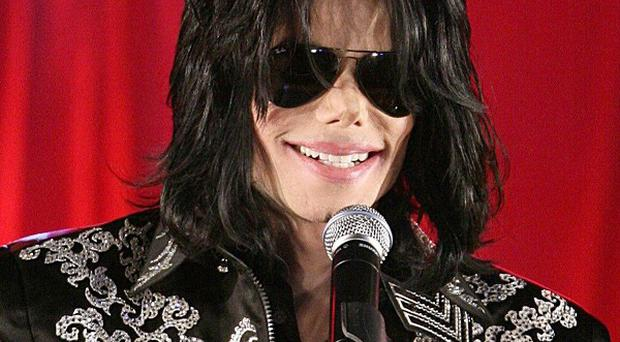 The late Michael Jackson is being tipped as a challenger to Take That for the Christmas number one album