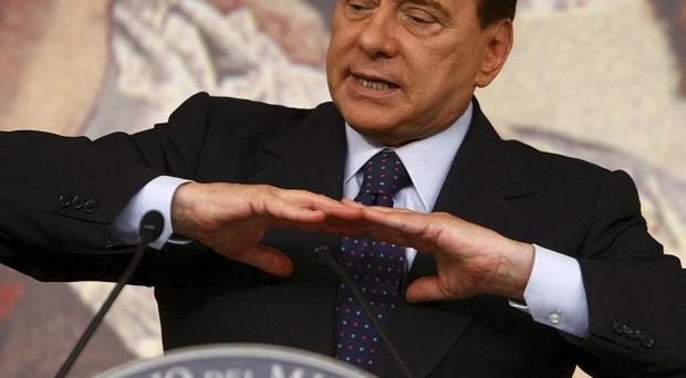 Italian Premier Silvio Berlusconi has scrapped a planned appearance at a conference on family values following further speculation about his private life (AP)
