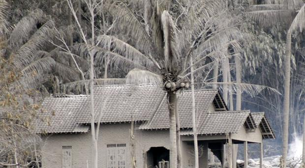 A house is covered with volcanic ash in Argomulyo, Yogyakarta, Indonesia(AP)