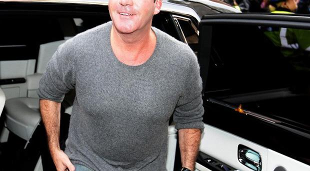 Simon Cowell has hinted at tension between mentor Cheryl Cole and her acts
