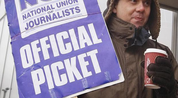 A man stands on the NUJ picket line at the BBC office in Glasgow