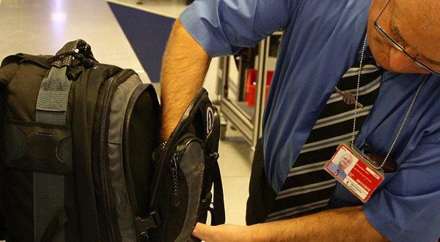 The discovery of explosive devices in aeroplane cargo has increased support for airport security checks, according to a survey