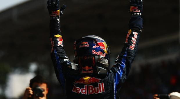 SAO PAULO, BRAZIL - NOVEMBER 07: Sebastian Vettel of Germany and Red Bull Racing celebrates in parc ferme after winning the Brazilian Formula One Grand Prix at the Interlagos Circuit on November 7, 2010 in Sao Paulo, Brazil. (Photo by Ker Robertson/Getty Images)