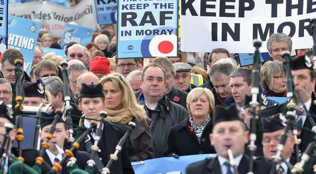 First Minister Alex Salmond joined a march in support of closure-threatened RAF Lossiemouth