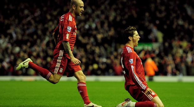 LIVERPOOL, ENGLAND - NOVEMBER 07: Fernando Torres (R) of Liverpool celebrates scoring his team's second goal with team mate Raul Meireles during the Barclays Premier League match between Liverpool and Chelsea at Anfield on November 7, 2010 in Liverpool, England. (Photo by Shaun Botterill/Getty Images)