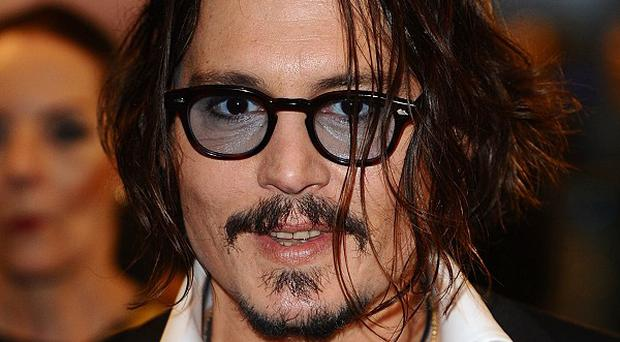Johnny Depp is working with Tim Burton again