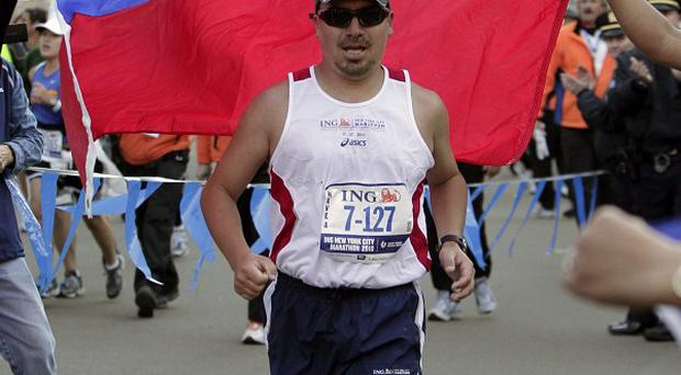 Chilean miner Edison Pena approaches the finish line after running in the New York City Marathon (AP)