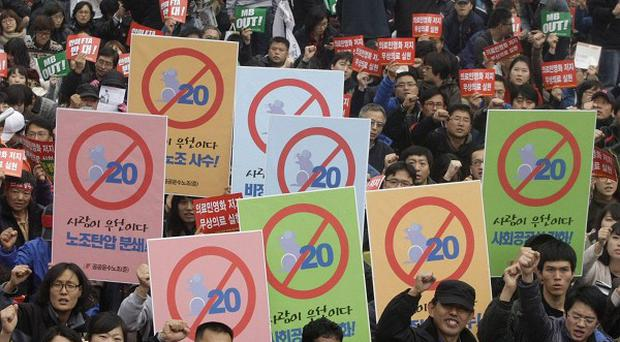 Protesters shout slogans during a rally against the upcoming G20 summit in South Korea (AP)