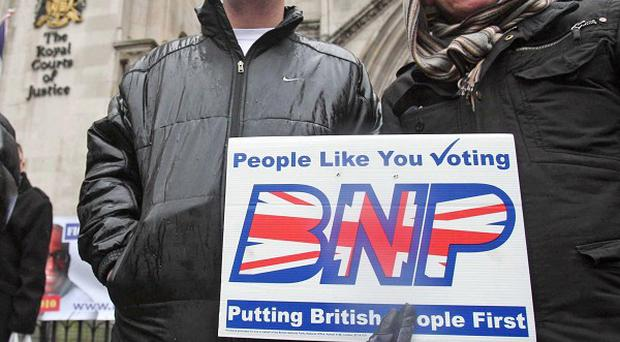 BNP supporters demonstrate at the Royal Courts of Justice as contempt of court proceedings are launched against party leader Nick Griffin