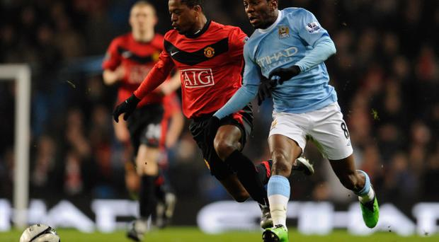 Patrice Evra (left), despite his poor Manchester United debut in 2006, loves the cut and thrust of a derby encounter and will be pumped up for tomorrow's game at Eastlands