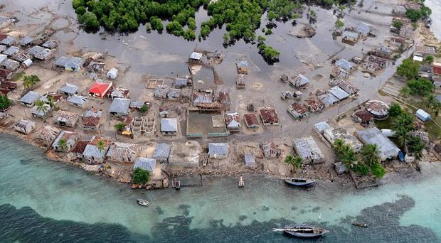 At least 20 people died when Hurricane Tomas brushed past Haiti, the country's civil protection department said (AP)