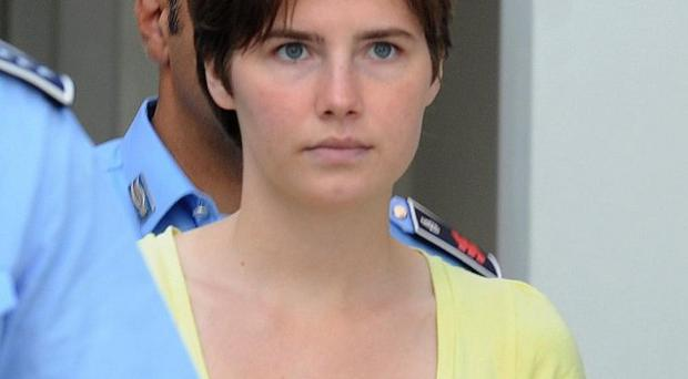 Jailed US student Amanda Knox has been indicted on charges she slandered police during questioning in 2007 (AP)