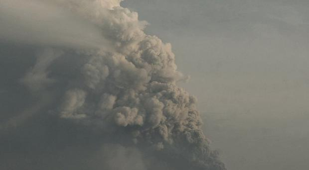 Mount Merapi spews volcanic ash into the air as seen from Cangkringan, Indonesia (AP)