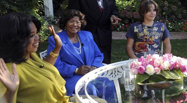 Oprah Winfrey ( left) with the Jackson family during an interview with Katherine Jackson (second from left) (AP/Harpo Productions)