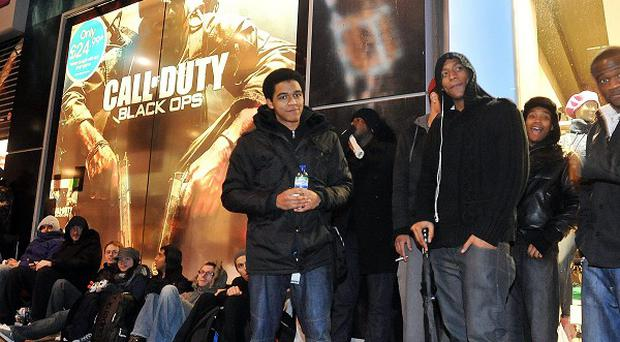 Gaming fans queue up to buy the new Call of Duty: Black Ops game, outside the Game store in Oxford Street, central London