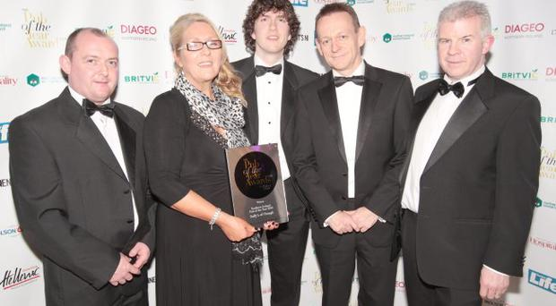 Paul Connolly (second right), Belfast Telegraph managing editor, joins the team from Sally's of Omagh to congratulate them on winning Northern Ireland Pub of the Year. With Paul are (from left) Michael Sharkey, Oonagh McGirr, John McGirr junior and Michael McBride