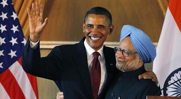 US President Barack Obama and Indian PM Manmohan Singh embrace following a joint press conference (AP)