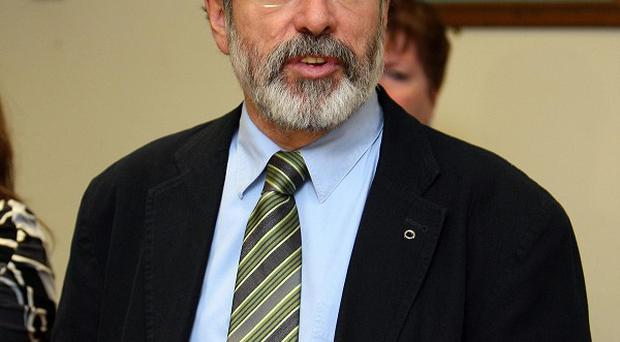 Gerry Adams claims to have won a commitment at St Andrews to introduce an Irish Language Act
