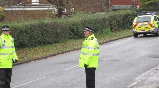 Police officers near the scene in Copthorne, West Sussex