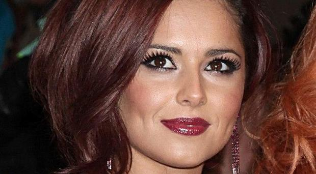X Factor judge Cheryl Cole graciously accepted a custard pie in the face