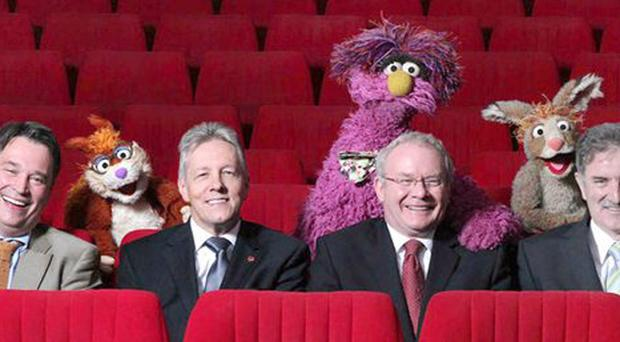 Richard Williams, Chief Executive Northern Ireland Screen; Peter Robinson, First Minister; Martin McGuinness, Deputy First Minister; and Denis Rooney CBE, Chairman, International Fund for Ireland pictured with Hilda, Potto and Archie from Sesame Tree