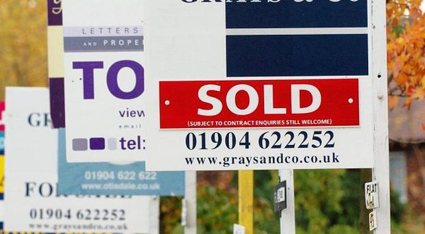Government spending cuts and fears of job losses are hitting the housing market, experts have said