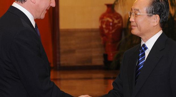 David Cameron met Chinese Premier Wen Jiabao on the first day of his trip