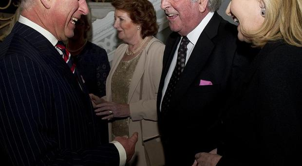 Britain's Prince of Wales (left) with Sir Terry Wogan at the Irish Embassy in London