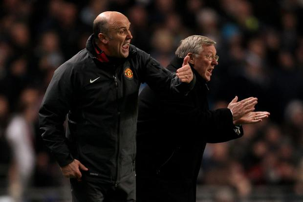 MANCHESTER, ENGLAND - NOVEMBER 10: Manchester United Manager Sir Alex Ferguson (R) and Assistant Mike Phelan encourage their players during the Barclays Premier League match between Manchester City and Manchester United at the City of Manchester Stadium on November 10, 2010 in Manchester, England. (Photo by Alex Livesey/Getty Images)