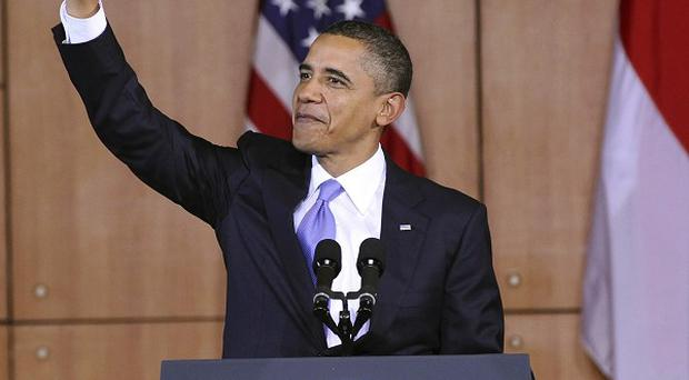US president Barack Obama greeted the audience at the University of Indonesia in Jakarta (AP)