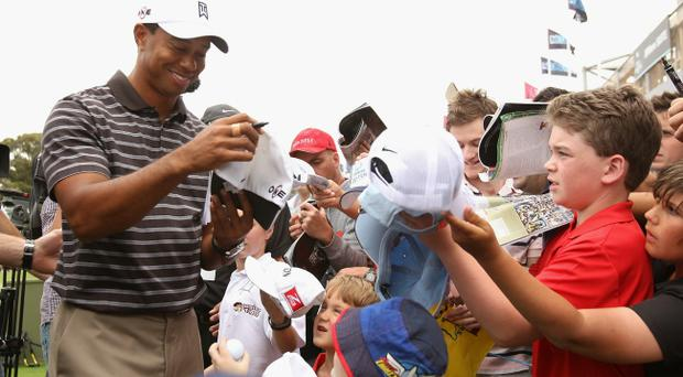 Tiger Woods' popularity hasn't waned in Australia as he signs autographs after the Pro-Am ahead of the Australian Masters at The Victoria Golf Club