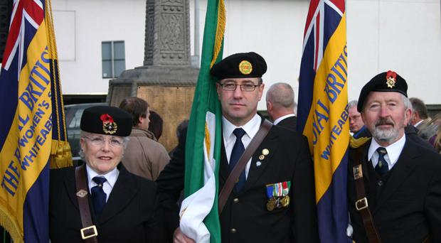 Rosalind Corr with Joe Lynch of ONE and Joe Corr, standard bearers from Whiteabbey Royal British Legion