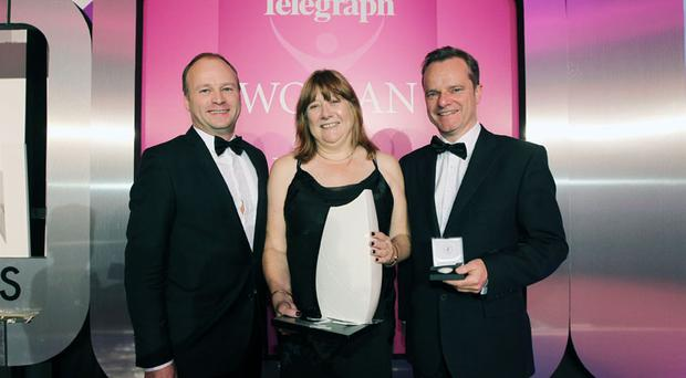Press Eye - Belfast - Northern Ireland - 3rd November 2010 - Picture by Kelvin Boyes / Press Eye.2010 Belfast Telegraph Woman of the Year Awards in Association with Victoria Square at the Ramada Hotel.10 BT Woman of the Year Winner - Penny Holloway with Sponsor: Hugh Black, Centre Manager, Victoria Square and Mike Gilson, Belfast Telegraph Editor.