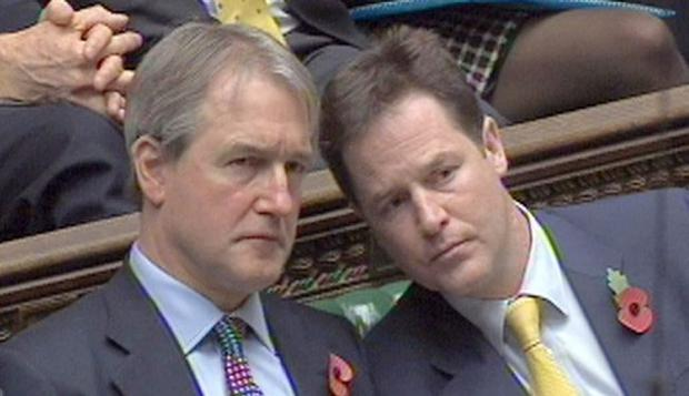 Secretary of State for Northern Ireland Owen Paterson and Deputy Prime Minister Nick Clegg
