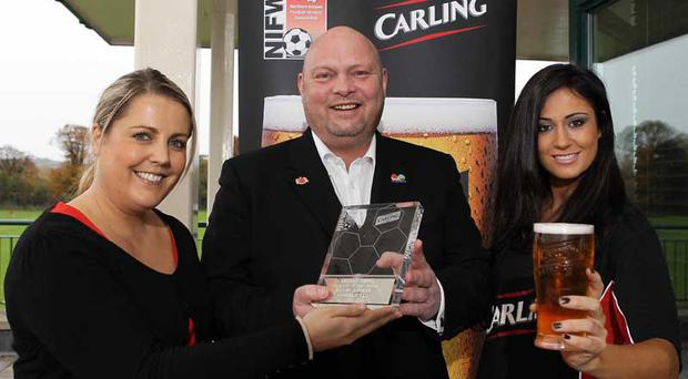 EMBARGO 0.01 am November 5, 2010BLUES boss David Jeffrey was awarded the Carling Northern Ireland Football Writers Association Manager of the Month award for October by Carlings Jordana Grimes and Natasha Shafai.
