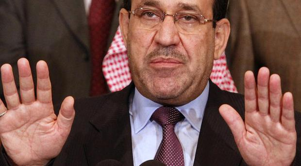 The agreed deal means Iraqi PM Nouri al-Maliki will return to power for another four-year term (AP)