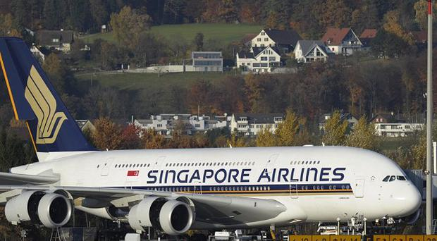 A Singapore Airlines Airbus A380 has its engine checked following the Qantas blow-out (AP)