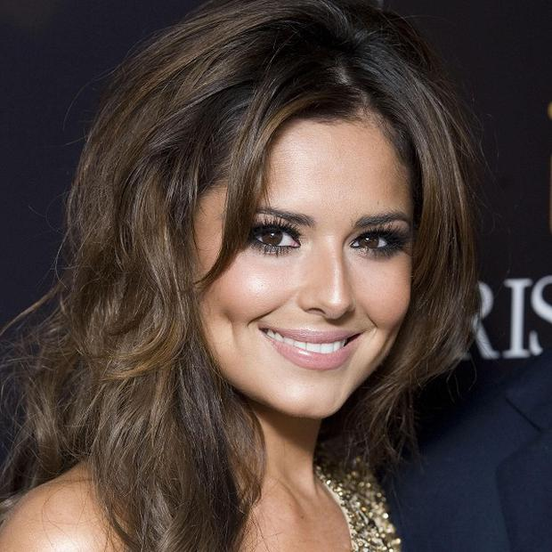 X Factor bosses reportedly considering a fifth judge in the wake of the furore over Cheryl Cole's refusal to vote