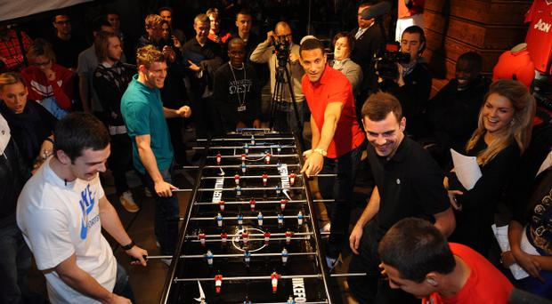 With no winner on the pitch, City and United players locked horns again yesterday at the opening of a new Nike store.